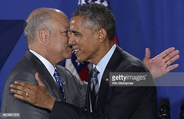 S President Barack Obama is greeted Secretary of the Department of Homeland Security Jeh Johnson before speaking at the Department of Homeland...