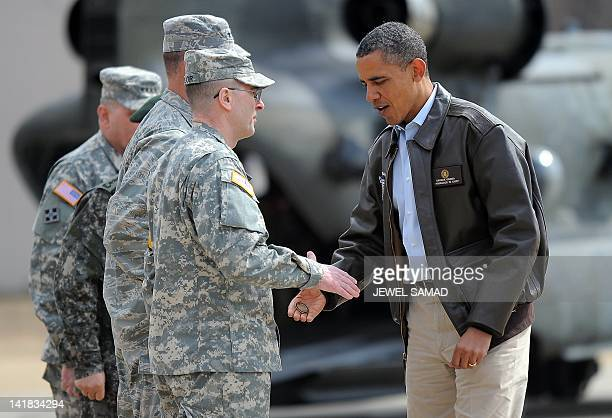 US President Barack Obama is greeted upon arrival at army base Camp Bonifas in Paju during a visit to the Demilitarized Zone on the border between...