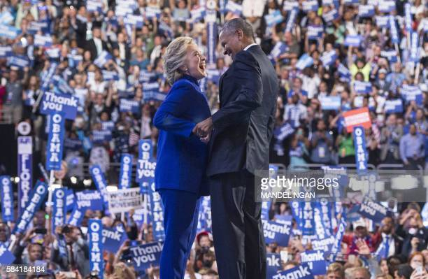 President Barack Obama is joined by US Democratic presidential candidate Hillary Clinton after his address to the Democratic National Convention at...