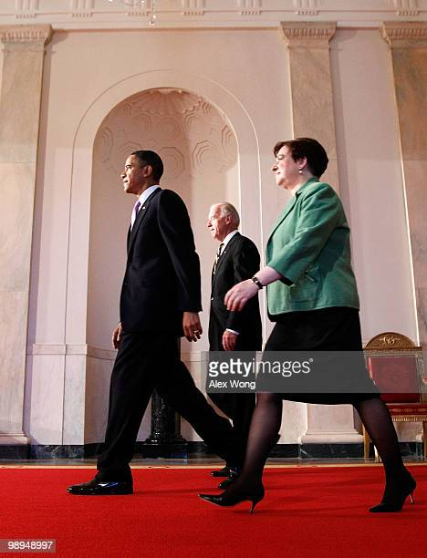 President Barack Obama is joined by Vice President Joe Biden and Solicitor General Elena Kagan as they walk toward the East Room to announce his...