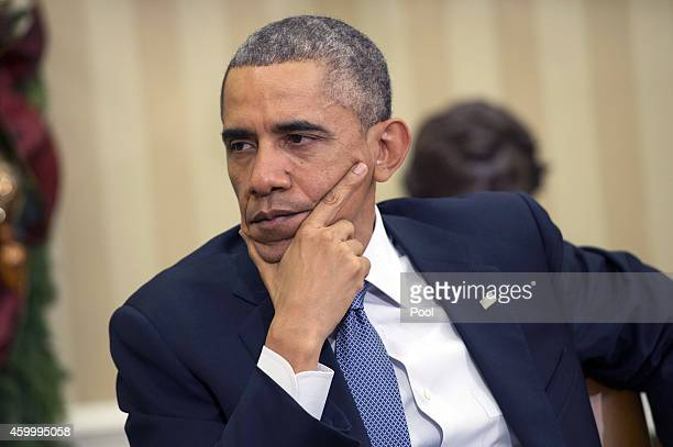 S President Barack Obama is seen during a meeting with King Abdullah II of Jordan in the Oval Office at the White House on December 5 2014 in...