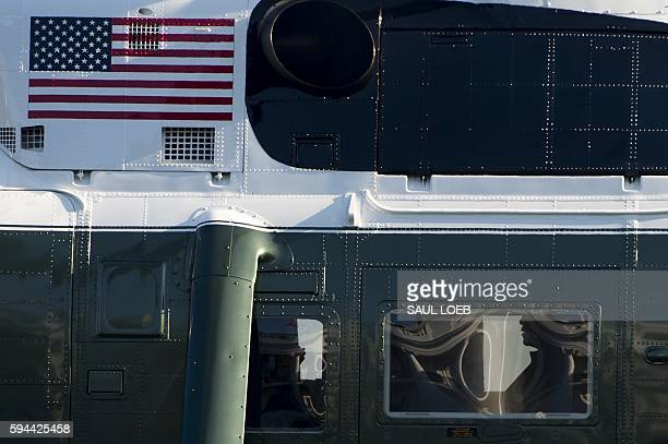 President Barack Obama is seen inside Marine One upon arrival on the South Lawn of the White House in Washington, DC, August 23 after traveling to...