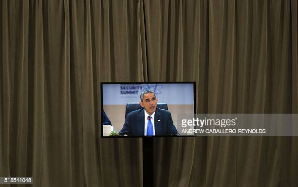 US President Barack Obama is seen on a monitor in the press room as he speaks during the 2016 Nuclear Security Summit in Washington DC April 1 2016 /...