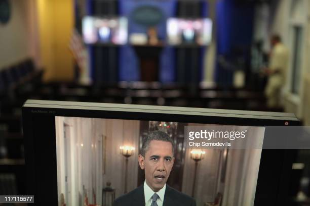 President Barack Obama is seen on live television screens in the Brady Press Briefing Room at the White House June 22, 2011 in Washington, DC. Obama...