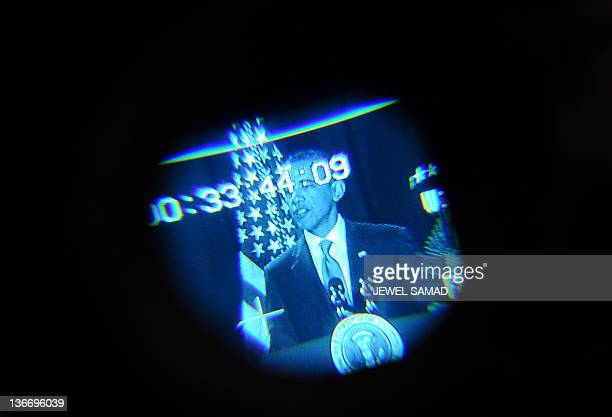 US President Barack Obama is seen through the viewfinder of a video camera as he speaks to employees of Environmental Protection Agency in Washington...