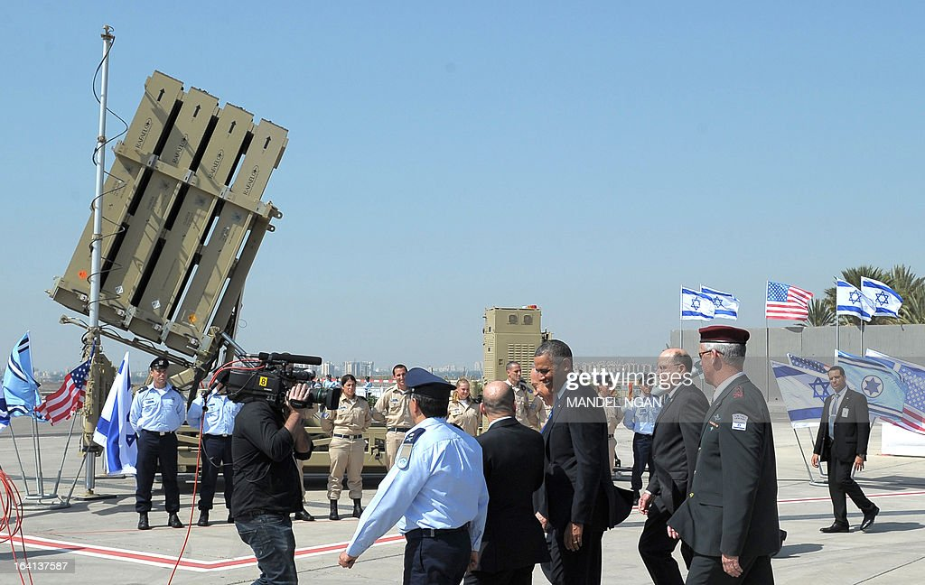 US President Barack Obama is shown an Iron Dome missile battery on March 20, 2013, at Ben Gurion International Airport on the outskirts of Tel Aviv. Obama landed in Israel for the first time as US president, on a mission to ease past tensions with his hosts and hoping to paper over differences on handling Iran's nuclear threat. AFP PHOTO/Mandel NGAN