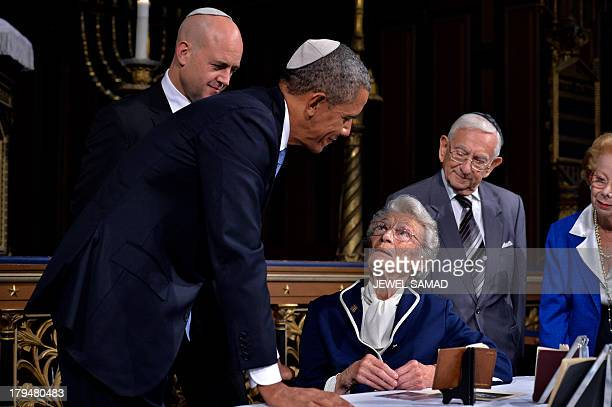 US President Barack Obama is shown artifacts of Raoul Wallenberg at the Great Synagogue and Holocaust Memorial of Stockholm on September 4 2013 in...
