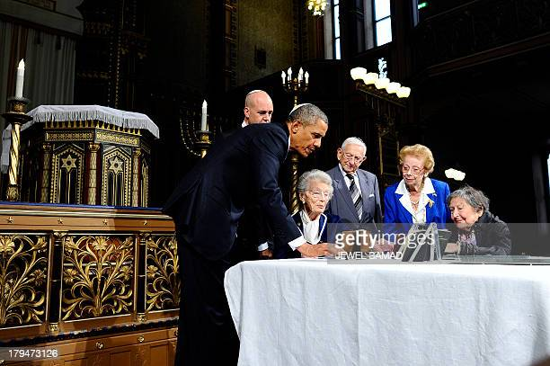 US President Barack Obama is shows artifacts of Raoul Wallenberg at the Great Synagogue and Holocaust Memorial of Stockholm on September 4 2013 in...