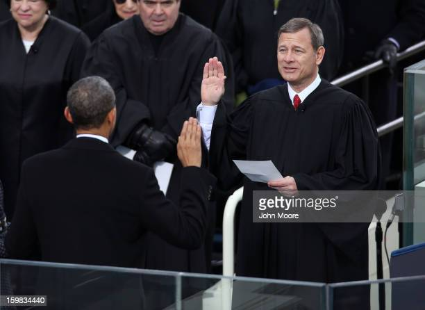 S President Barack Obama is sworn in during the public ceremony by Supreme Court Chief Justice John Roberts during the presidential inauguration on...