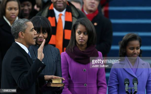 S President Barack Obama is sworn inas First lady Michelle Obama and daughters Sasha Obama and Malia Obama look on during the public ceremonial...