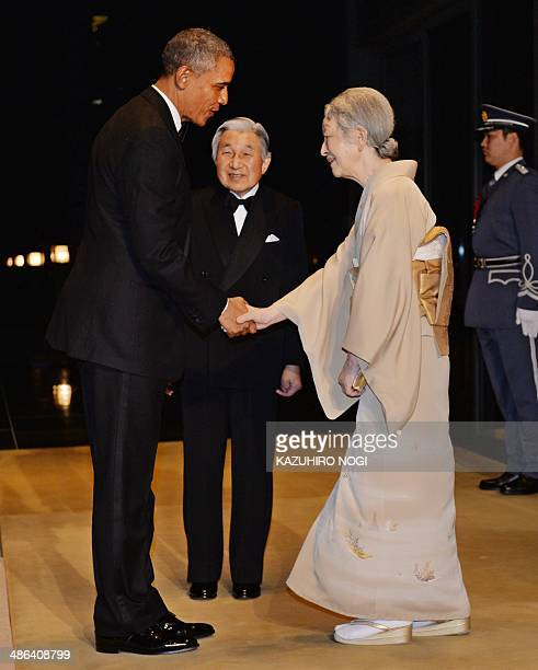 US President Barack Obama is welcomed by Emperor Akihito and Empress Michiko prior to the Japan State Dinner at the Imperial Palace in Tokyo on April...