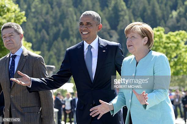 President Barack Obama is welcomed by Germany's Chancellor Angela Merkel and her husband Joachim Sauer upon arrival at a breakfast meeting with local...