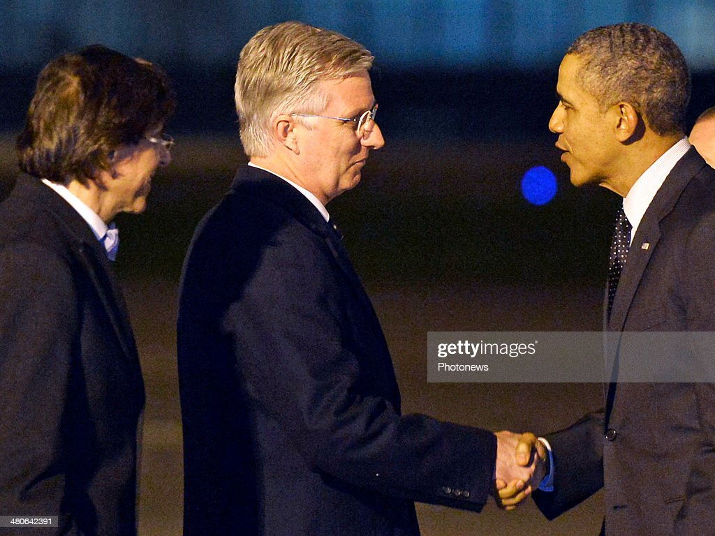 US President Barack Obama is welcomed by King Philippe of Belgium (C) and Belgian Prime Minister Elio Di Rupo (L) at Zaventem Airport on March 25, 2014 in Brussels, Belgium. Obama is on a week-long trip during which he will visit the Netherlands, Belgium, Italy and Saudi Arabia.