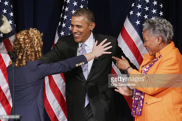 S President Barack Obama is welcomed to the stage by Democratic National Committee Chair Rep Debbie Wasserman Schultz and Donna Brazile during the...