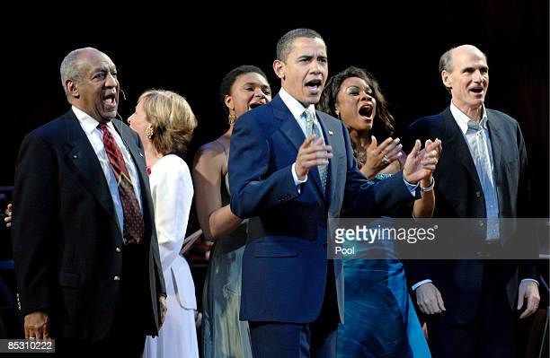 S President Barack Obama joins performers including host comedian Bill Cosby and musician James Taylor on stage to lead in singing Happy Birthday to...