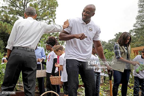 S President Barack Obama jokes with Alonzo Mourning former NBA AllStar and member of the President's Council on Fitness during an event to harvest...