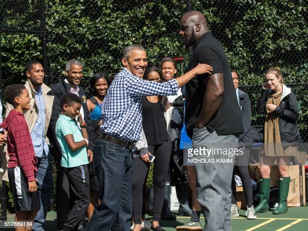 US President Barack Obama jokes with former basketball player Shaquille O'Neal at the annual Easter Egg Roll at the White House in Washington DC on...