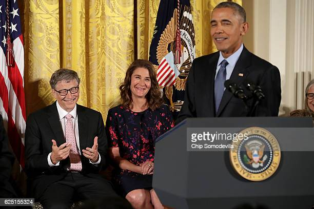 S President Barack Obama jokes with Microsoft founder Bill Gates and his wife Melinda Gates before presenting the Presidential Medal of Freedom to 21...