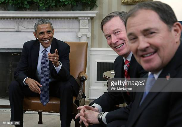 S President Barack Obama jokes with National Governors Association Chairman Gov John Hickenlooper and Vice Chairman Gov Gary Herbert in the Oval...