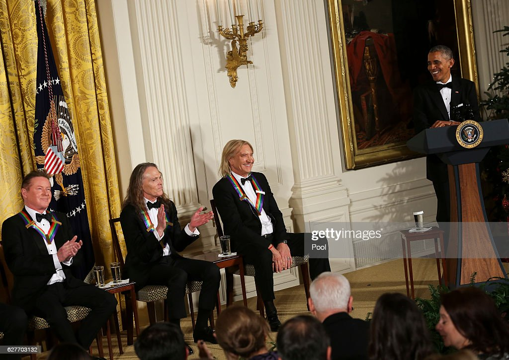 President Barack Obama jokes with three band members of the Eagles during a ceremony for the 2016 Kennedy Center honorees December 4, 2016 in the East Room of the White House in Washington, DC. The honorees also include actor Al Pacino and singer James Taylor.