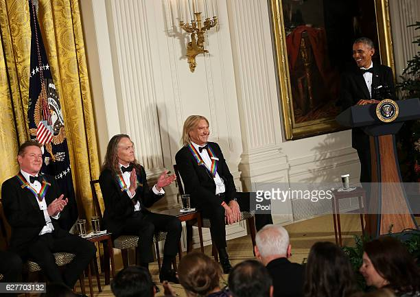 President Barack Obama jokes with three band members of the Eagles during a ceremony for the 2016 Kennedy Center honorees December 4 2016 in the East...