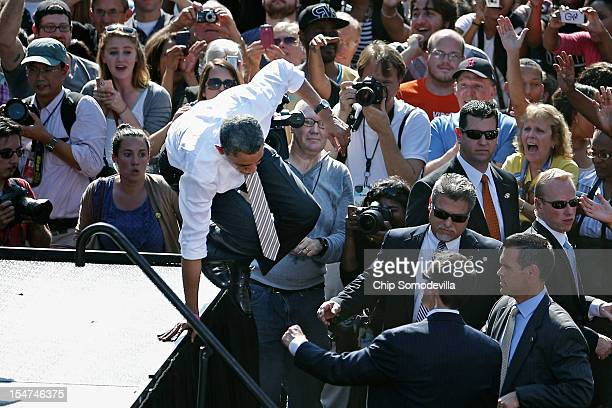 S President Barack Obama jumps down from the stage during a campaign rally at Byrd Park October 25 2012 in Richmond Virginia With less than two weeks...