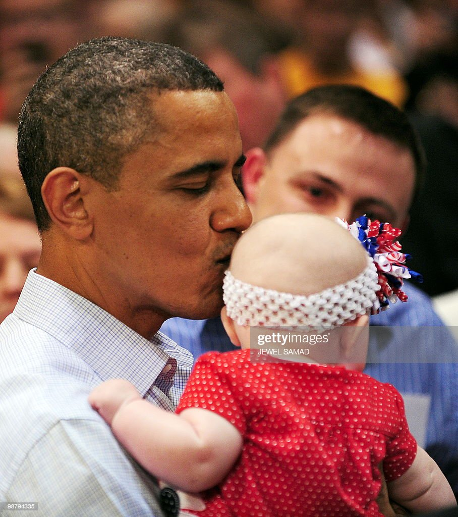 US President Barack Obama kisses 5-months-old Cameron Bonnel after speaking during a townhall meeting at Indian Hills Community College in Ottumwa, Iowa, on April 27, 2010. AFP PHOTO/Jewel Samad