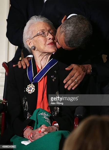 President Barack Obama kisses former NASA mathematician Katherine G. Johnson after he presented her with the Presidential Medal of Freedom during an...