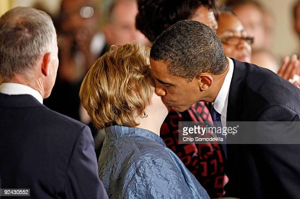 S President Barack Obama kisses Judy Shepard Matthew Shepard's mother after delivering remarks following the enactment of the Matthew Shepard and...