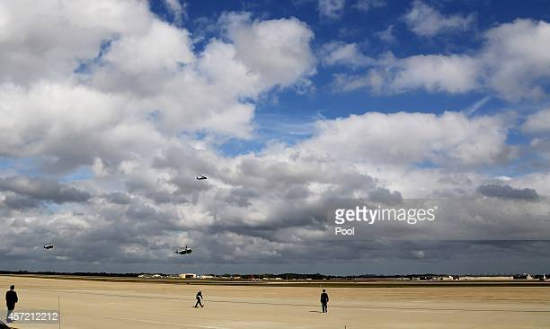 S President Barack Obama lands on Marine One on October 14 2014 at Andrew Air Force Base in Maryland Obama is arriving for a meeting with foreign...