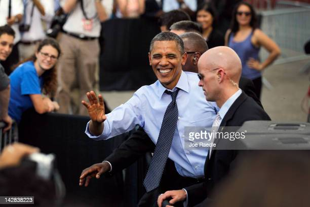President Barack Obama laughs as he greets people during a visit to the Port of Tampa on April 13, 2012 in Tampa, Florida. The President, on his way...