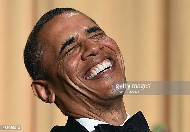 US President Barack Obama laughs as he listens performer Joel McHale telling jokes during the White House Correspondents Association Dinner on May 3...
