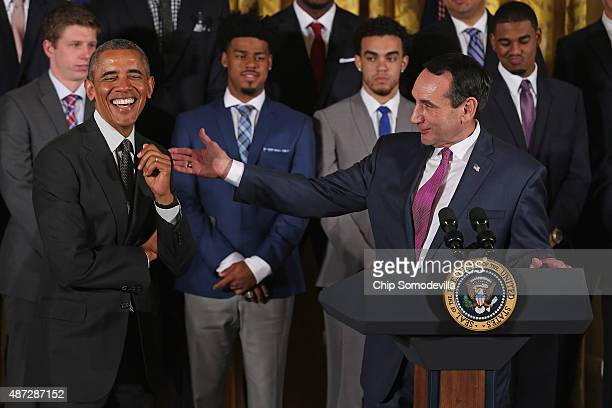 S President Barack Obama laughs at a joke told by NCAA champion Duke University men's basketball head coach Mike Krzyzewski during an event with the...