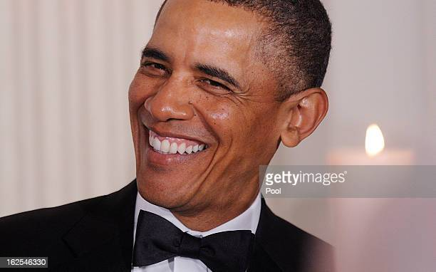 S President Barack Obama laughs during a event with the National Governors Association in the State Dining Room of the White House on February 24...