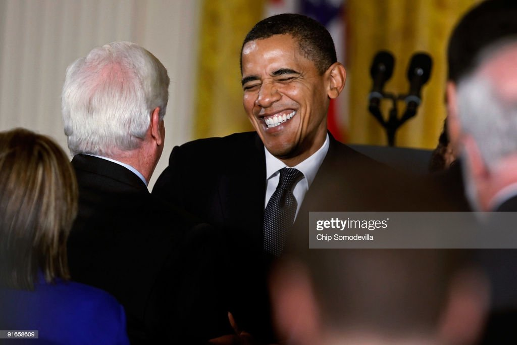 U.S. President Barack Obama (C) laughs with Senate Banking and Urban Affairs Committee Chairman Christopher Dodd (D-CT) after making remarks about finanacial institution regulation reform in the East Room of the White House October 9, 2009 in Washington, DC. Obama said he supports the creation of Consumer Financial Protection Agency.