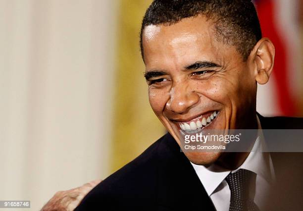 S President Barack Obama laughs with Senate Banking and Urban Affairs Committee Chairman Christopher Dodd after making remarks about finanacial...