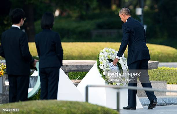 US president Barack Obama lays a wreath at the Hiroshima Peace Memorial park cenotaph in Hiroshima on May 27 2016 Obama became the first sitting US...