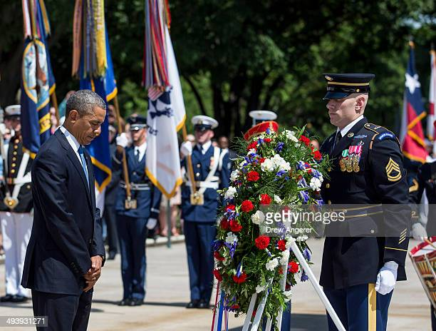 S President Barack Obama lays a wreath at the Tomb of the Unknown Soldier at Arlington National Cemetery May 26 2014 in Arlington Virginia Obama...