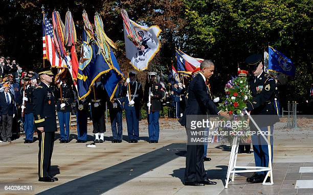 US President Barack Obama lays a wreath at the Tomb of the Unknown Soldier at Arlington National Cemetery November 11 2015 in Arlington Virginia...