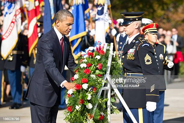 President Barack Obama lays a wreath during a Veterans' Day ceremony at Arlington National Cemetery in Arlington, Virginia, on November 11, 2012. AFP...