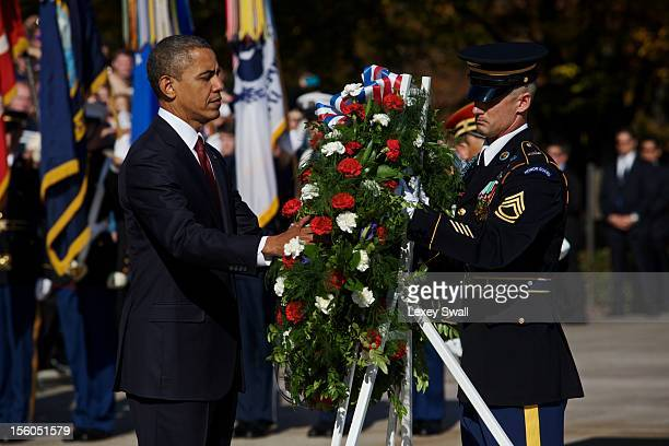S President Barack Obama lays a wreath in front of the Tomb of the Unknowns during the Presidential WreathLaying Ceremony at Arlington National...