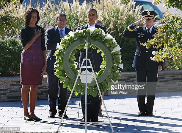 S President Barack Obama lays a wreath while flanked by his wife first lady Michelle Obama Secretary of Defense Leon Panetta and Chairman of the...