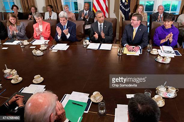 US President Barack Obama leads his cabinet in a round of applause for Attorney General Loretta Lynch and Defense Secretary Ashton Carter during...