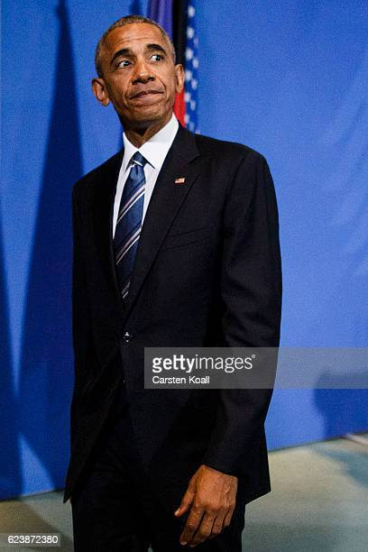 US President Barack Obama leaves a press conference with German Chancellor Angela Merkel at the Chancellery on November 17 2016 in Berlin Germany...