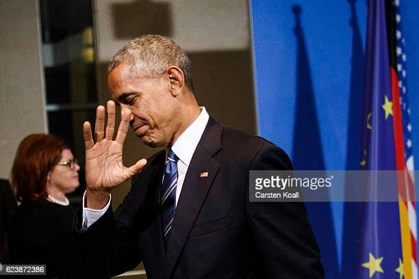 S President Barack Obama leaves a press conference with German Chancellor Angela Merkel at the Chancellery on November 17 2016 in Berlin Germany...