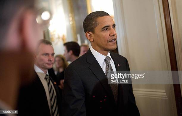 US President Barack Obama leaves a reception in the State Dining Room after signing the Lilly Ledbetter Fair Pay Act at the White House in Washington...