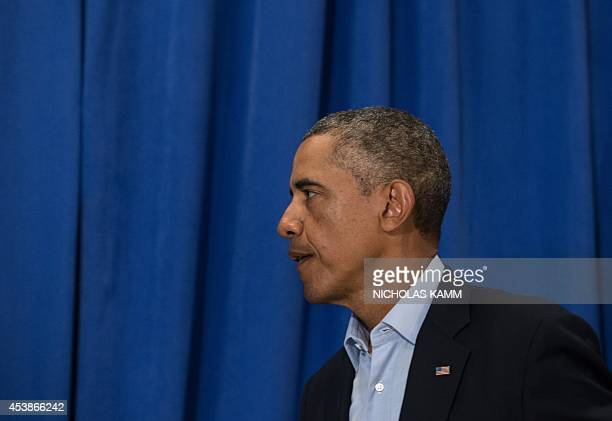 US President Barack Obama leaves after making a statement to the press on the death of American journalist James Foley at Martha's Vineyard...