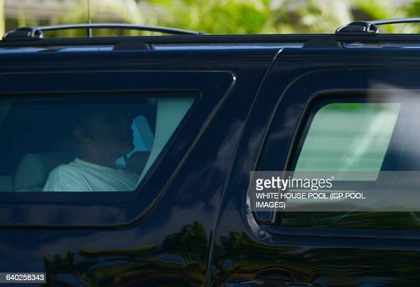 President Barack Obama leaves Kailuana Place in Kailua Hawaii with the first family as they head out on a beach outing Later we arrived at Bellows...