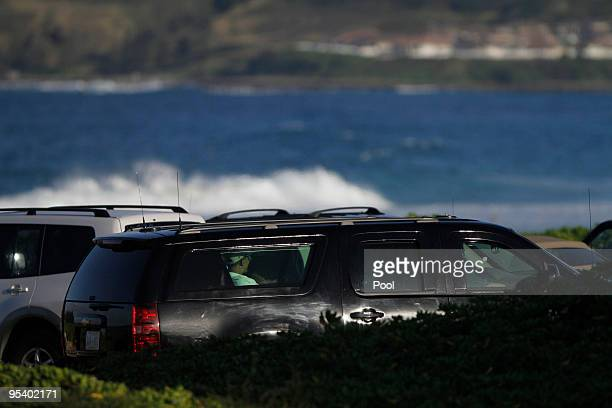 US President Barack Obama leaves Pyramid Rock Beach at Marine Corps Base Hawaii on December 26 2009 in Kailua Hawaii Obama and his family arrived in...