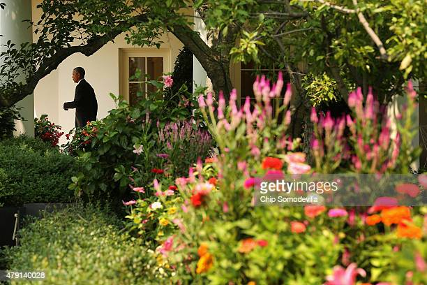 S President Barack Obama leaves the Oval Office and walk past the Rose Garden before departing the White House for a day trip to Tennessee July 1...